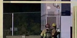 Firefighters moments before an explosion tore through a lithium-ion battery energy storage system.