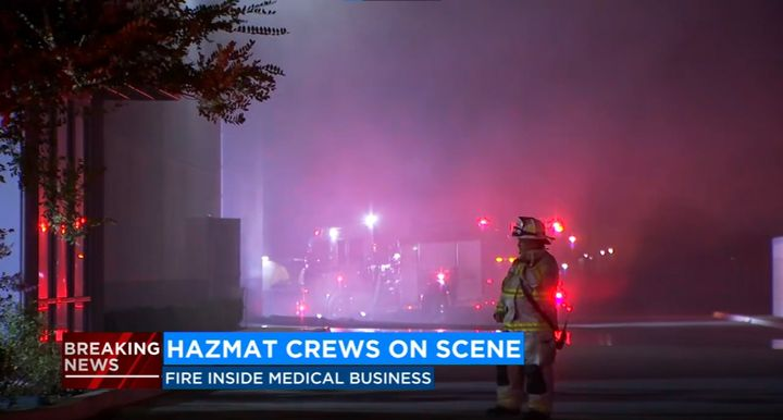 Sprinklers activated at a medical supply warehouse in California Wednesday. - Screencapture Via KFSN