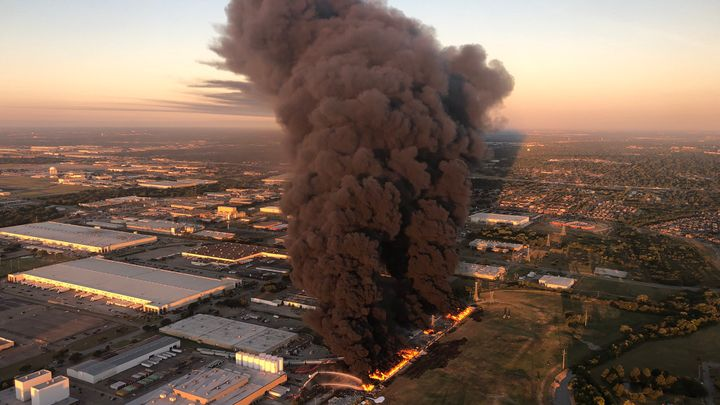 Towering smoke dominated the Dallas-Fort Worth skyline Wednesday morning after fire broke out at a plastics plant. - Screencapture Via KXAS