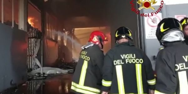 Firefighters battle food processing plant fire Wednesday in Italy.