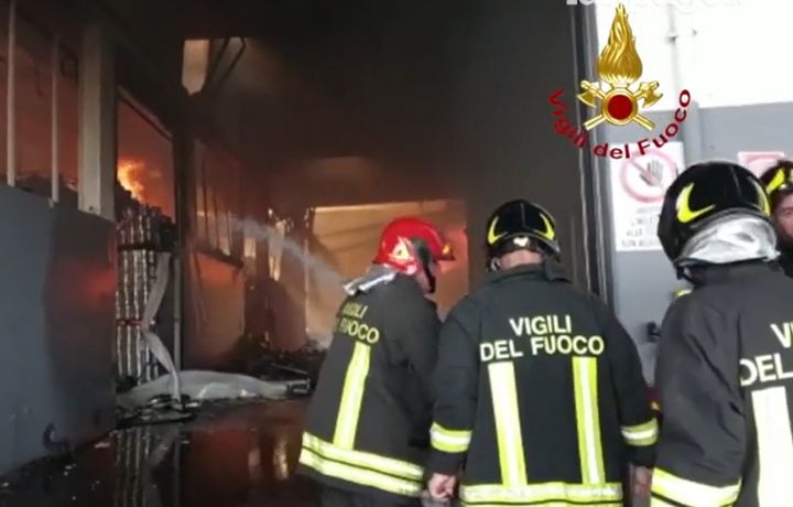 Firefighters battle food processing plant fire Wednesday in Italy. - Photo Courtesy of Vigili Del Fuoco
