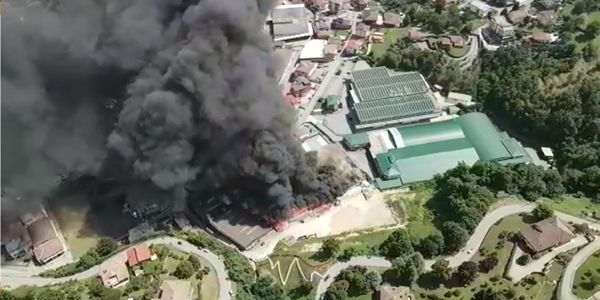 Aerial view of a textile factory burning in Italy Friday afternoon.
