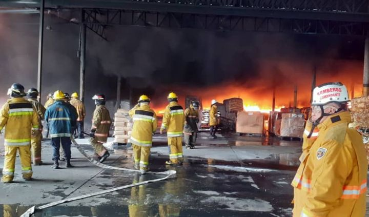 A warehouse for rubber in Venezuela went up in flames Saturday morning. - Photo courtesyof REDAN Central de Bomberos y Bomberos