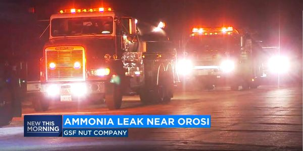 Fire trucks wait Thursday morning near Orosi, California, as the source of leaking ammonia is...