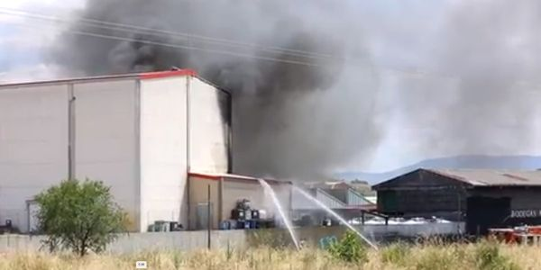 Firefighters battle a varnish factory Monday in Spain.