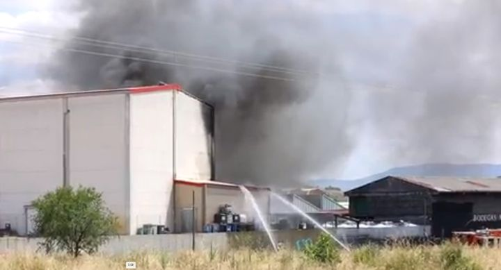 Firefighters battle a varnish factory Monday in Spain. - Screencapture via La Rioja