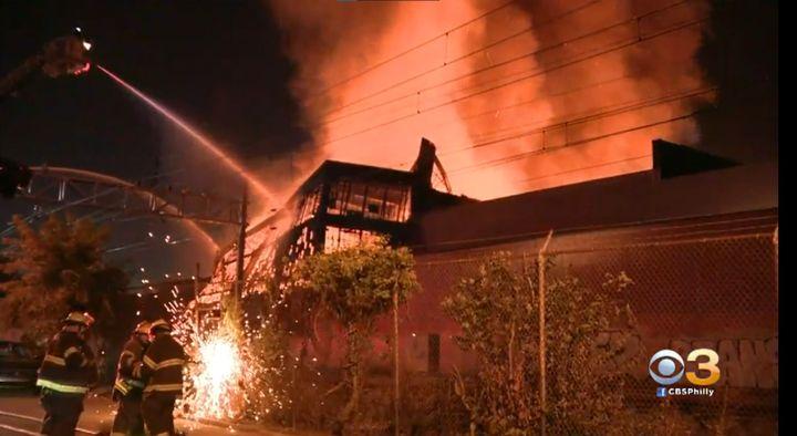 Philadelphiafirefighters battle a six-alarm warehouse fire Sunday morning. - Screencapture Via KYW