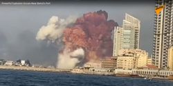 Screencapture from a video showing a massive explosion bursting from a large warehouse fire near Beirut's port Tuesday.