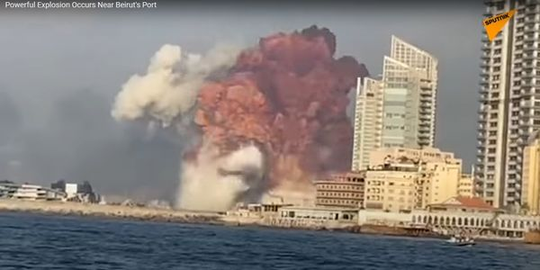 Screencapture from a video showing a massive explosion bursting from a large warehouse fire near...
