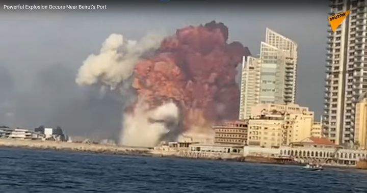 Screencapture from a video showing a massive explosion bursting from a large warehouse fire near Beirut's port Tuesday. - Screencapture Via Sputnik