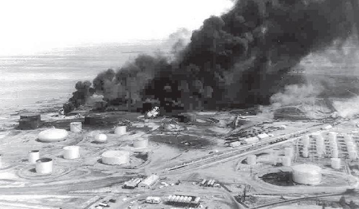 Aerial view of the flaming Diamond Shamrock refinery near Sunray, Texas, in July 1956. - Photo Courtesy of Valero