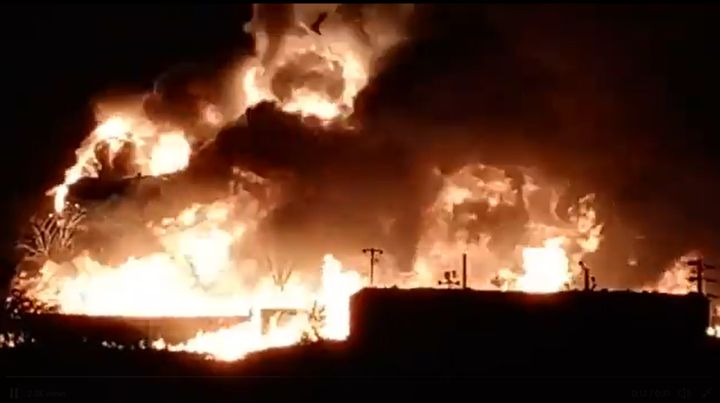 Flames engulf a chemical plant warehouse Saturday night in India. - Screencapture Via Twitter