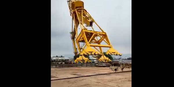 Video shows a crane at a shipyard in India toppling during a load test Saturday.