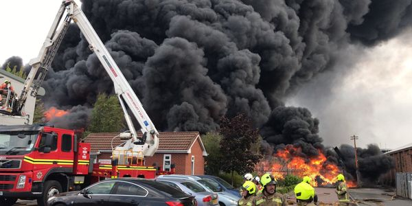An aerial device is brought to bear against a plastics factory fire Monday in England.