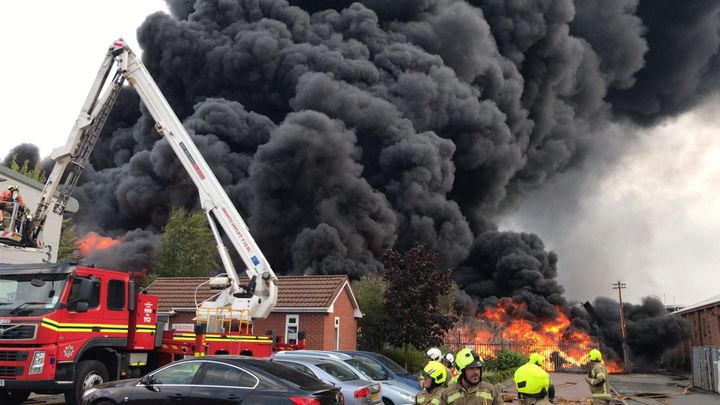 An aerial device is brought to bear against a plastics factory fire Monday in England. - Photo Courtesy of West Midlands Fire and Rescue Service
