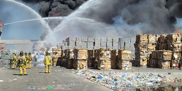 Flames race through baled material stored outside at a recycling plant in Albuquerque, New Mexico.