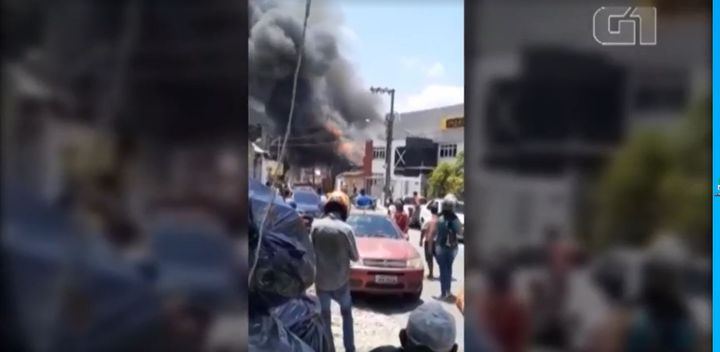 Residents rush to the scene of a cleaning supplies factory fire Thursday in Brazil. - Screencapture Via Globo.com