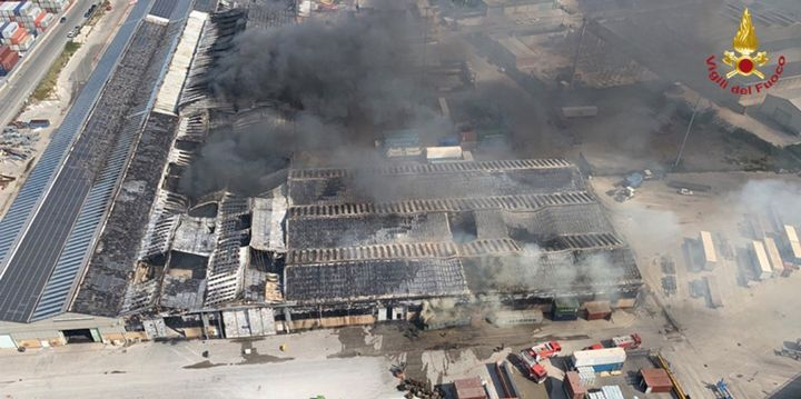 A fire in Ancona, Italy, raced through nearly 40,000 meters of warehouse space Wednesday morning. - Photo Courtesy of Corpo Nazionale Dei Vigili Del Fuoco