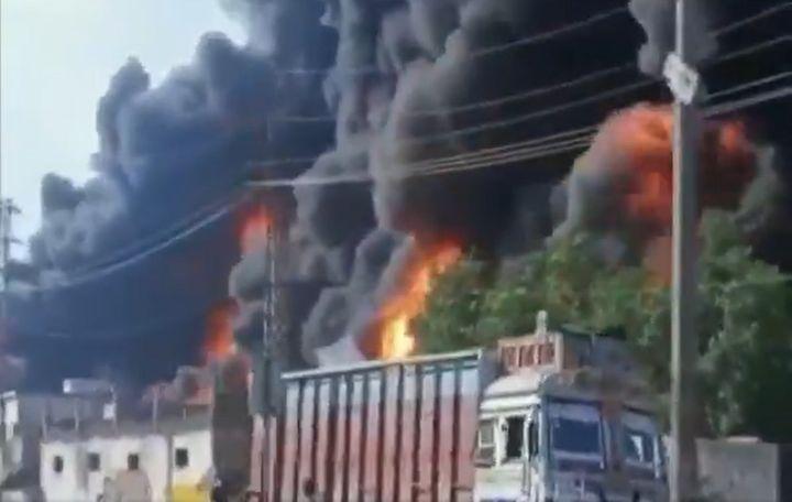 Smoke engulfs a burning chemical plant in northern India Sunday. - Screencapture Via ANI News