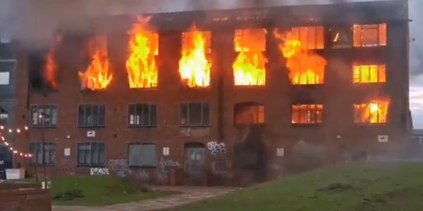 Flames gutted the upper story of a derelict factory in Walsall, England, Wednesday night.