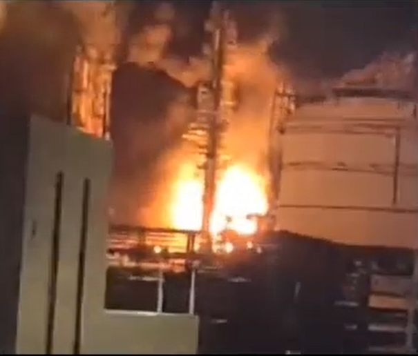 Flames light up a petrochemical plant Saturday night in the Philippines. - Screencapture Via J&J TV