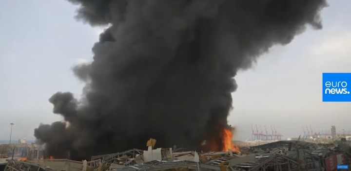 A warehouse fire Thursday fills the sky above Beirut with smoke Thursday. - Screencapture Via Reuters