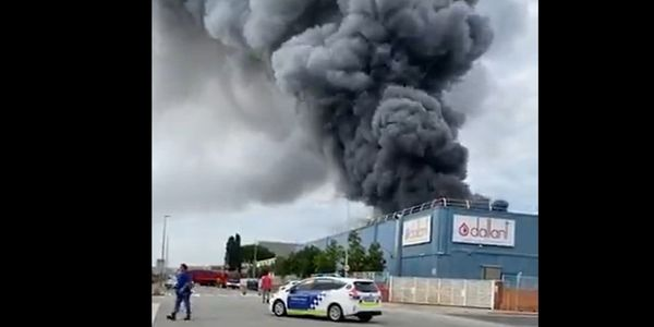 A column visible for miles rises from a burning food ingredients plant Wednesday in Spain.