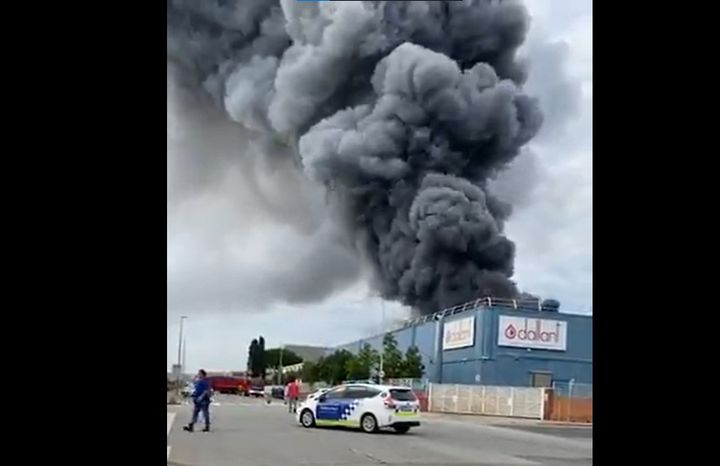 A column visible for miles rises from a burning food ingredients plant Wednesday in Spain. - Screencapture Via Facebook