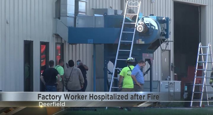 Firefighters clean up after a dust collector fire at a Wisconsin factory that sent a worker to the hospital. - Screencapture Via WKOW
