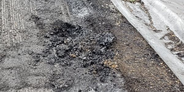 Highway pavement damaged in the semi-rig tanker fire Sunday in Giles County, Virginia.