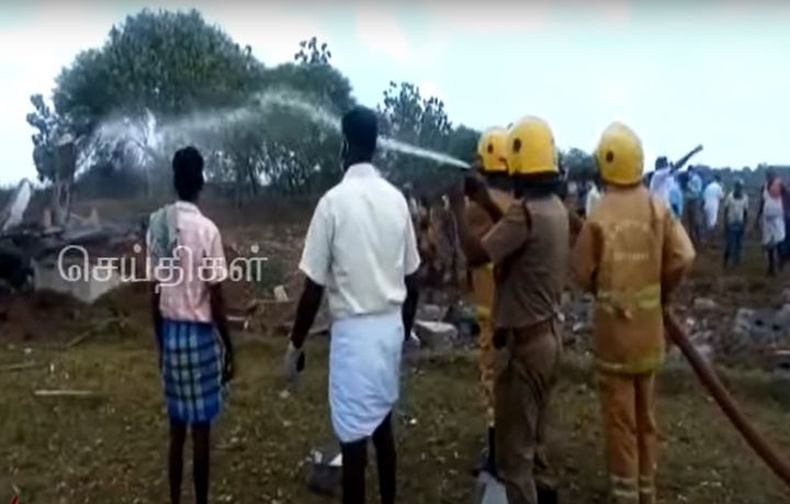 Firefighters extinguish hot spots after fireworks factory blast Friday in India. - Screencapture Via Kalaignar TV News