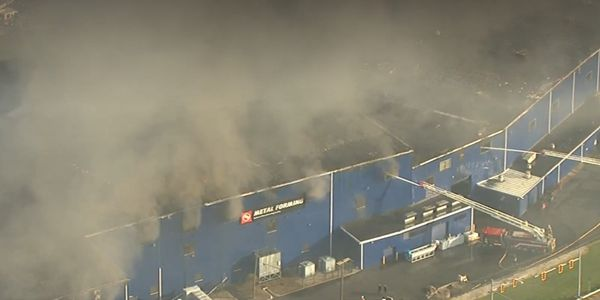 Smoke all but obscures the firefighting efforts on the ground during a factory fire in Ohio Tuesday.