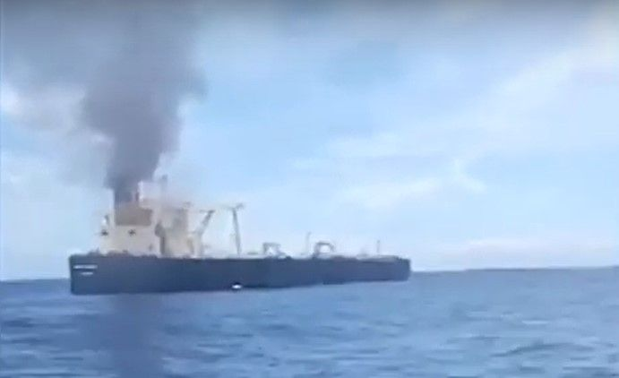 Smoke from an engine room fire rises from the funnel of a crude tanker off the coast of Sri Lanka - Screencapture Via Web Focus Media