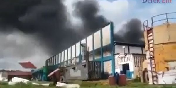 Fire consumes mattress factory Monday in Uganda.