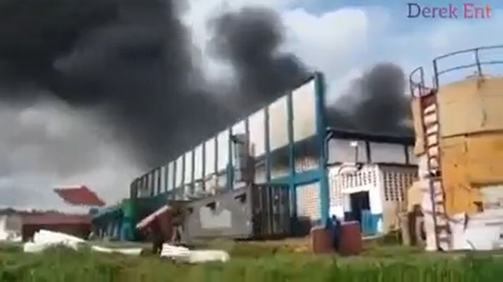 Fire consumes mattress factory Monday in Uganda. - Screencapture Via YouTube