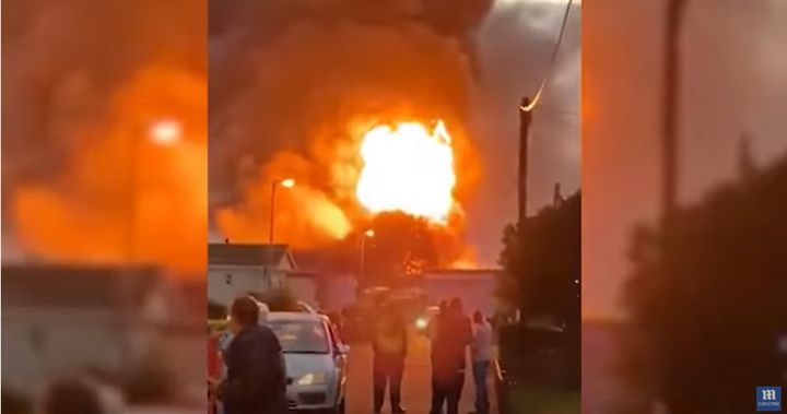 Fireballs rise from a burning industrial building Friday near Rochester, England. - Screencapture Via Daily Mail
