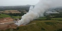 Fire broke out at a recycling plant in west central England Thursday morning.