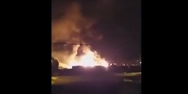 Flames rise from a burning canning factory Tuesday in Argentina.
