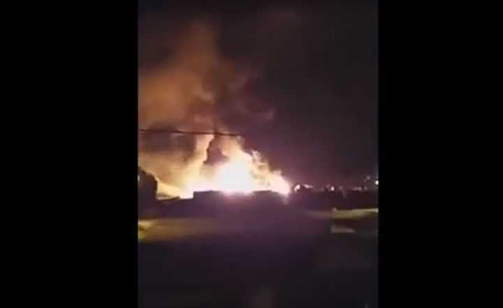 Flames rise from a burning canning factory Tuesday in Argentina. - Screencapture Via Cadena 3