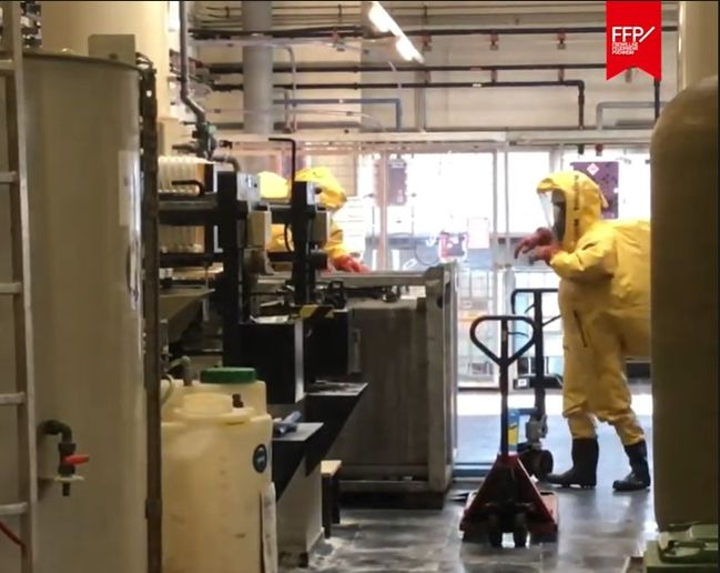 Hazmat responders remove a leaking container from a commercial enterprise in Austria Thursday. - Photo Courtesy of FF Puchheim