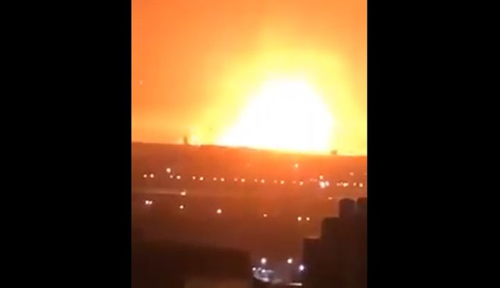 A munitions warehouse explosion illuminates the sky Friday morning in Zarqa, Jordan. - Screencapture Via Twitter