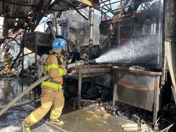 South Korean firefighter battles flames at a burning Styrofoam factory Tuesday in Daegu. - Photo Courtesy of Daegu Fire and Safety Department