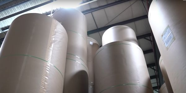 Giant rolls of corrugated paper waiting to be used.