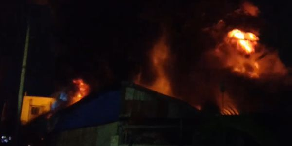 Fire spread through a tire factory Wednesday in Bangladesh.