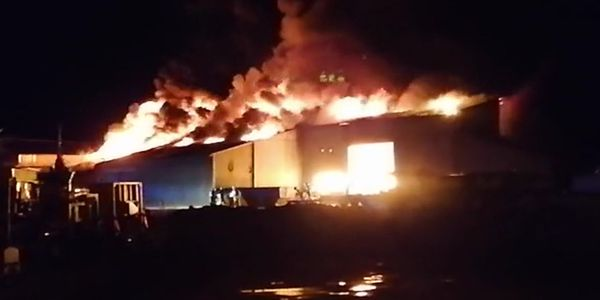 Flames gut a warehouse at a boat factory Wednesday in Digoin, France.