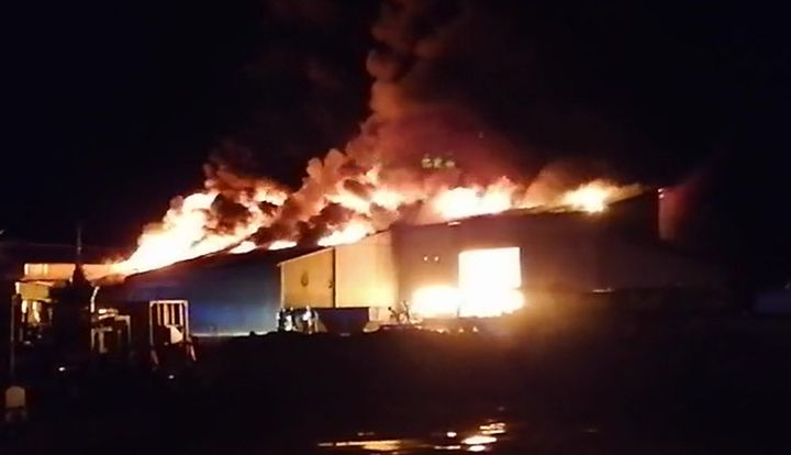 Flames gut a warehouse at a boat factory Wednesday in Digoin, France. - Screencapture Via Le Journal