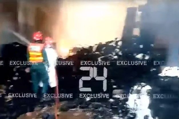 After 12 hours ablaze, a textile plant in Pakistan continued to burn Thursday. - Screencapture Via 24 News HD