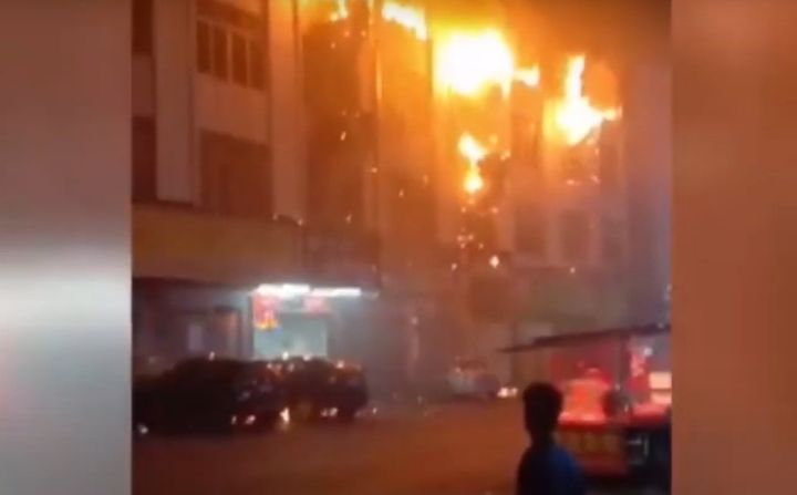 Upper floors of a factory in south China caught fire Monday morning. -