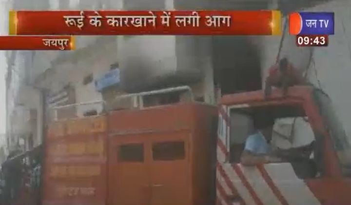 Firefighters attend a factory fire Sunday in India. - Screencapture Via JAN TV
