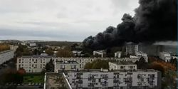Smoke rises from a burning warehouse Saturday in Le Harve, France.